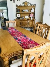 Elegant blonde wood dining room table (two leaves to make full banquet) and eight chairs