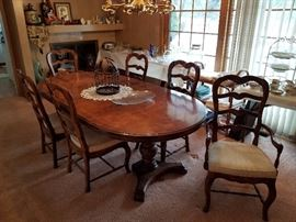 formal dining table , with six chairs, one leaf