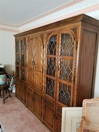 8 ft three piece wall unit with center unit a bar