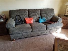 Like new sofa--Purses 2 coach and 1 Aigner