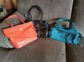 Coach and Aigner purses