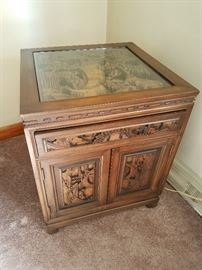 One of two Asian end tables--Much Carving including sides