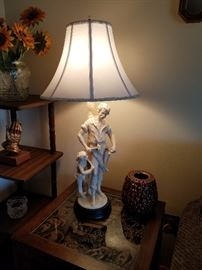 Other in pair of figural lamps