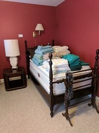 One of a pair twin poster beds, quilt stand