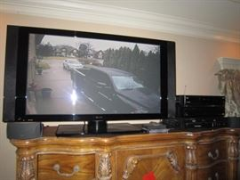 Pioneer flatscreen tv with added speaker system and receiver