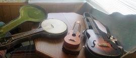 """the Gibson"" tenor banjo, Washburn Soprano Ukulele By Lyon & Healy, and possibly Gibson guitar"