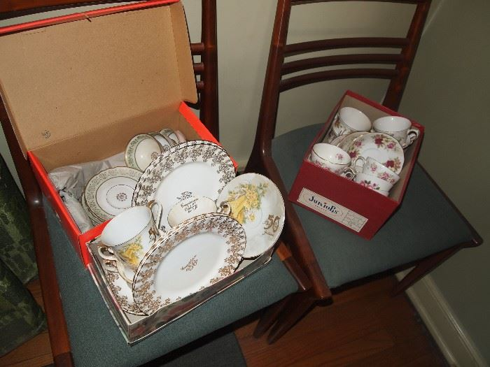 Lots of teacups and saucers