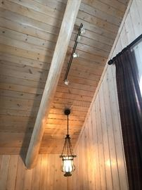 Lighting fixtures, decorative beams and Wall Paneling... all for sale!  Buyer is responsible for removal