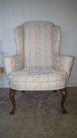 Circa 1710 English Queen Anne walnut wing chair with boldish shape frame & scrolled arms, the seat front bowed, on cabriole legs and pad feet at the front & back. Purchased in 1978