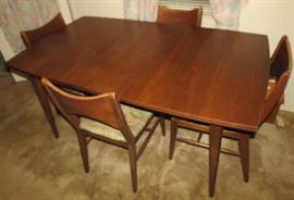 Beautiful Danish Mid Century Formal dining table with 4 chairs and extra leaf.
