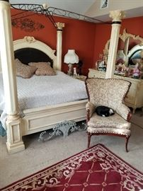 beautiful canopy bed and matching bed room set with a triple dresser and armoire dresser mirror and two night stands