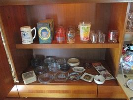 Ashtray collection housed in the entertainment center