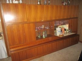 Danish Modern wall unit with a drop down bar and storage from top to bottom.  Three pieces.  Teak veneer purchased in Germany in 1969.  We can provide resources to help move it!
