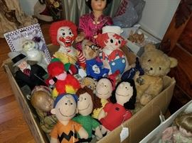 stuffed toys/dolls, including Charlie Brown, Ronald McDonald, old teddy bear, Raggedy Andy, WC Fields