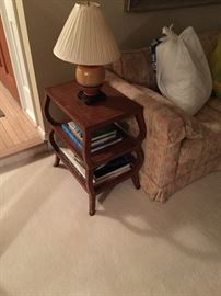 Small side table with 2 shelves next to one of matching couches for sale