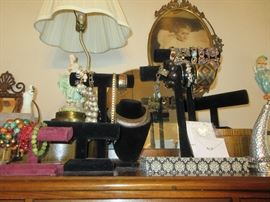 A whole room filled with vintage jewelry, accessories, Hats etc.