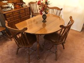 Vintage solid maple drop leaf table with two leaves and six chairs