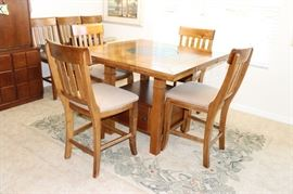 From Haverty's solid quality furniture, round granite lazy susan in the middle.