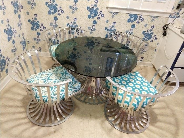 AHA! Then we have the STAR of the show!                             A vintage Russell Woodard aluminum dining table, with four matching chairs - truly a find at this sale!