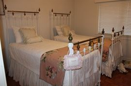 Pair of matching antique white iron and brass twin beds with mattresses (including bedding)