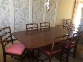 Vintage dining room table and chairs with matching buffet
