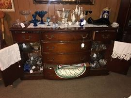 Bow front buffet and a variety of china pieces
