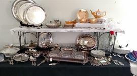 silver plate serving items along with lusterware tea set
