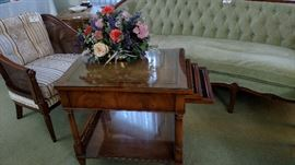 serving cart has 3 removable trays, leather top under glass with metal wheels