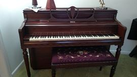 piano with needle point piano bench