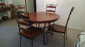 Wood and metal dining table with 4 chairs. Matching Baker Rack also available.