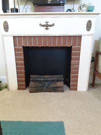 Vintage electric log fireplace. Decoration only.