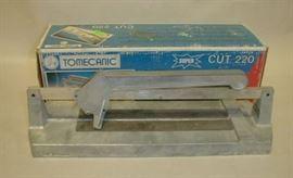Tomecanic tile cutter