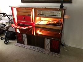 Vintage fire place that opens to a bar & turn table..Way cool!