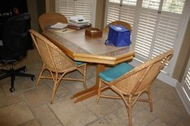 Handcrafted table by the owner with 4 wicker chairs