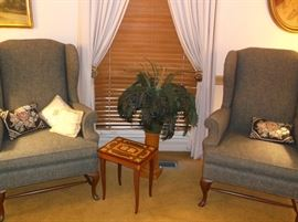 Pair of wing back chairs and inlaid music box jewelry cabinet