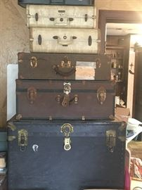 Assorted trunks and suitcases