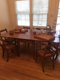 Krauss Dining table with 8 chairs, drop leaf sides, 6 side chairs and two arm chairs.  Quality solid walnut