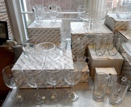 Lots of brand new Princess House crystal glasses, water goblets, mugs, chip & dip, vase, large footed fruit bowl.