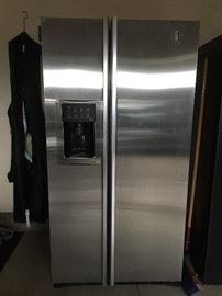 Stainless GE side by side refrigerator/freezer