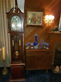 Grandmother clock, MCM Drexel Cabinet. Hand Blown Art Glass Decanter and Goblets. Gold Foil Botanical