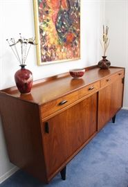 A beautiful solid wood mid-century buffet in excellent condition.