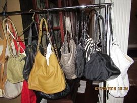 purses are NOT 75% off but they have been reduced.
