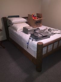 Full size log bed Very nice clean!! Newer mattress and box