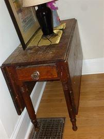 Primitive drop-leaf gate-leg table