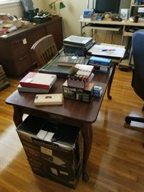 large office with office supplies books and desk and vintage cadenza with filing cabinet