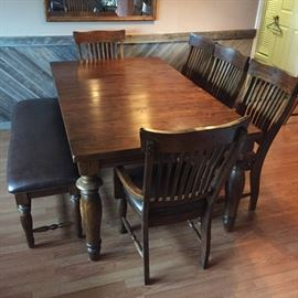 Beautiful walnut dining room table with leaf that comes up from the middle  with chairs and bench