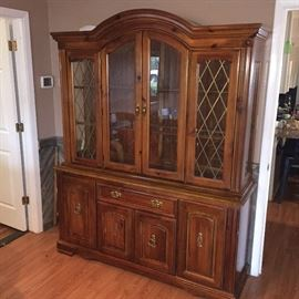 Very nice China cabinet lighted with glass shelves and glass front. Comes into pieces