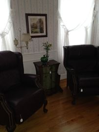 Two more matching recliners; small side table in between