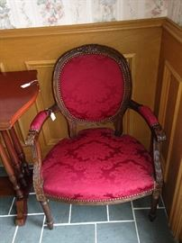 One of two matching antique parlor chairs