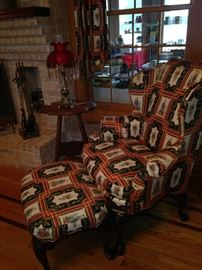 One of two Asian print wingback chairs & ottoman